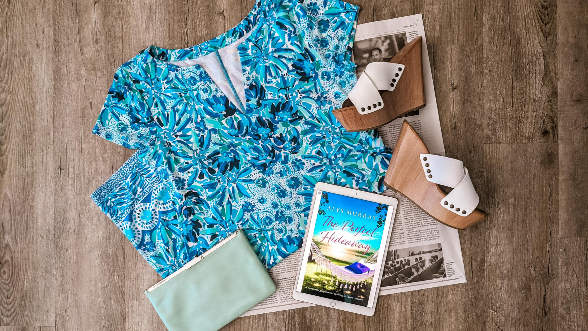 The Perfect Hideaway book pictured with a Lilly Pulitzer dress and heels